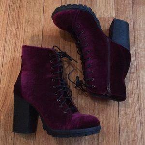 Burgundy velvet heeled boots.